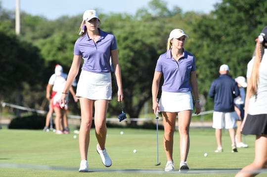 Wylie's Maddi Olson, left, and Tatum McClellan walk off the putting  green before the first round of the 2019 Class 5A state tournament at the White Wing Golf Club in Georgetown. Olson and McClellan were the only two returners from last year's sixth-place team on this year's roster.