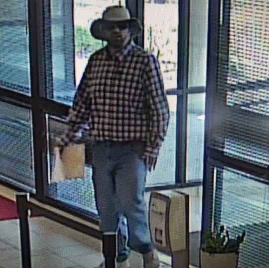 Surveillance image of the suspect at First Citizens Bank on Smokey Park Highway