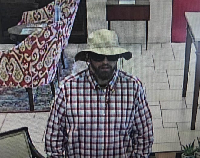 Surveillance image of the suspect in First Citizens Bank on Smokey Park Highway.