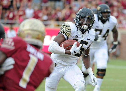 Wake Forest Demon Deacons wide receiver Cortez Lewis (15) runs the ball during the game against the Florida State Seminoles at Doak Campbell Stadium.