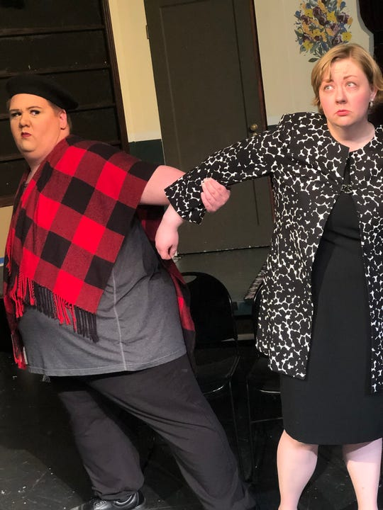 Director Gerry Dunbar (Robin Abille, left) attempts to forcibly remove playwright Phyliss Montague (Molly Olmstead) from a rehearsal.