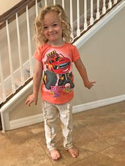 """Isabella is all smiles after putting on her new """"Blaze and the Monster Machines"""" T-shirt."""