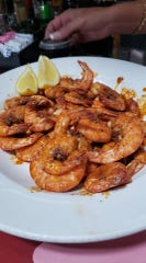 Venessa Ruiz said the Cajun peel-n-eat shrimp at Ashley's in Rockledge are perfect with a cold beer.