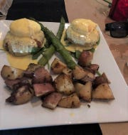 Crab cakes Benedict was just one of the dishes Lourdes Risco tried recently at Snug Pub and Eatery in Cocoa Village.