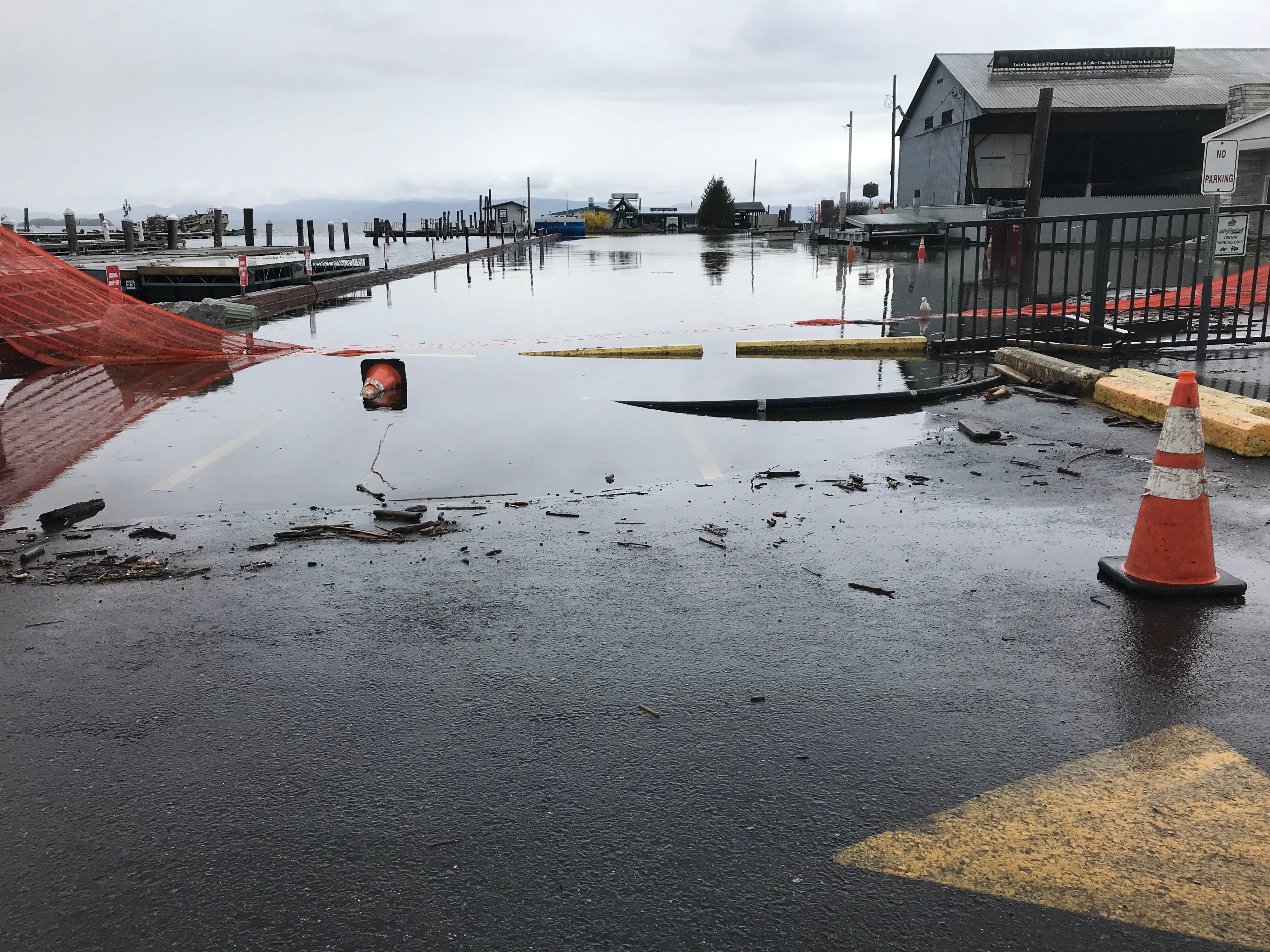 The Burlington Ferry Dock parking lot remains flooded on Tuesday, May 14, 2019.