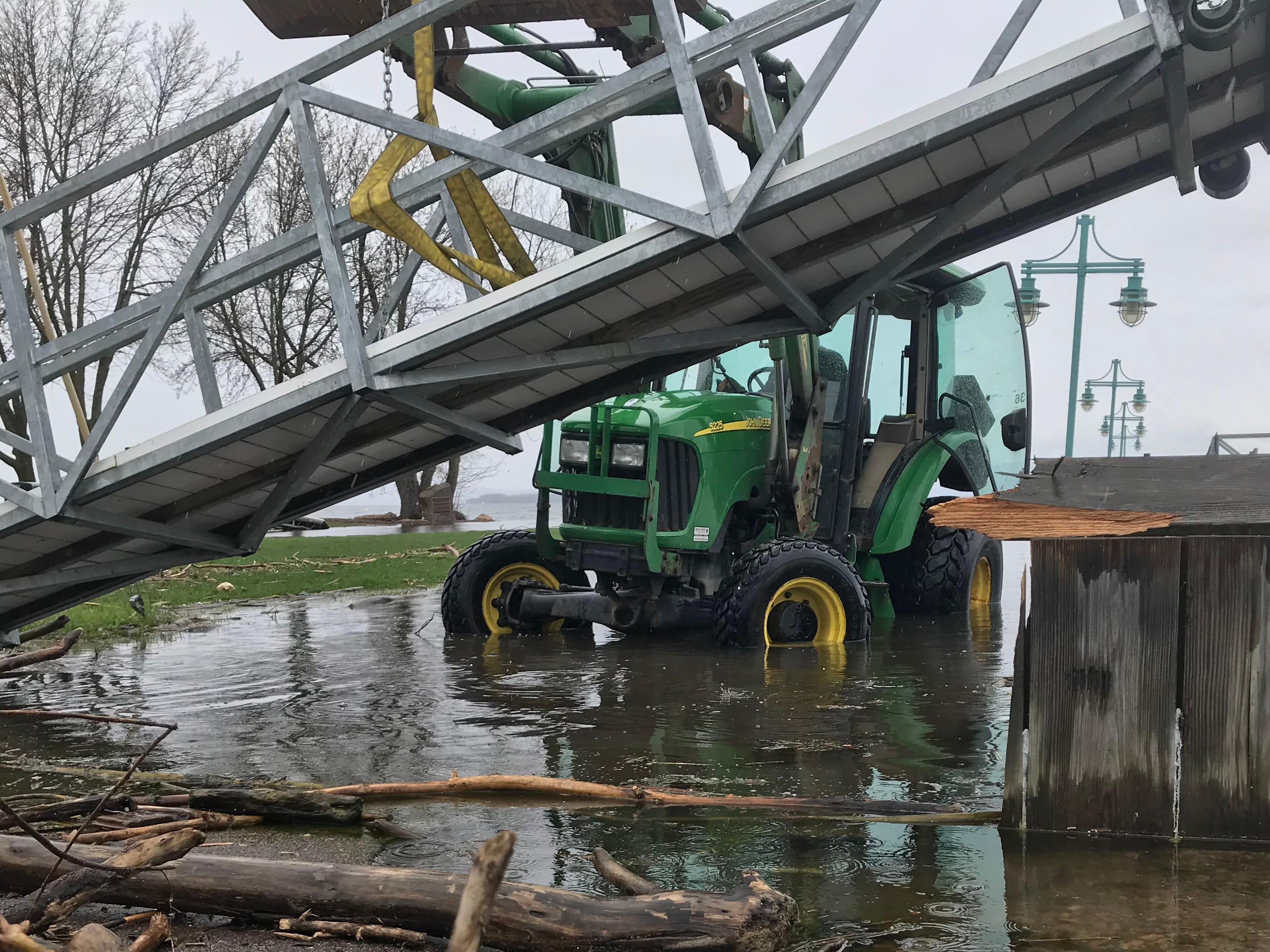Kurt Hawkins, an event and marina specialist with Burlington Department of Parks, Recreation and Waterfront, lifts a gangway into position at Perkins Pier on Tuesday, May 14, 2019. Lake Champlain is in its third week at flood stage.