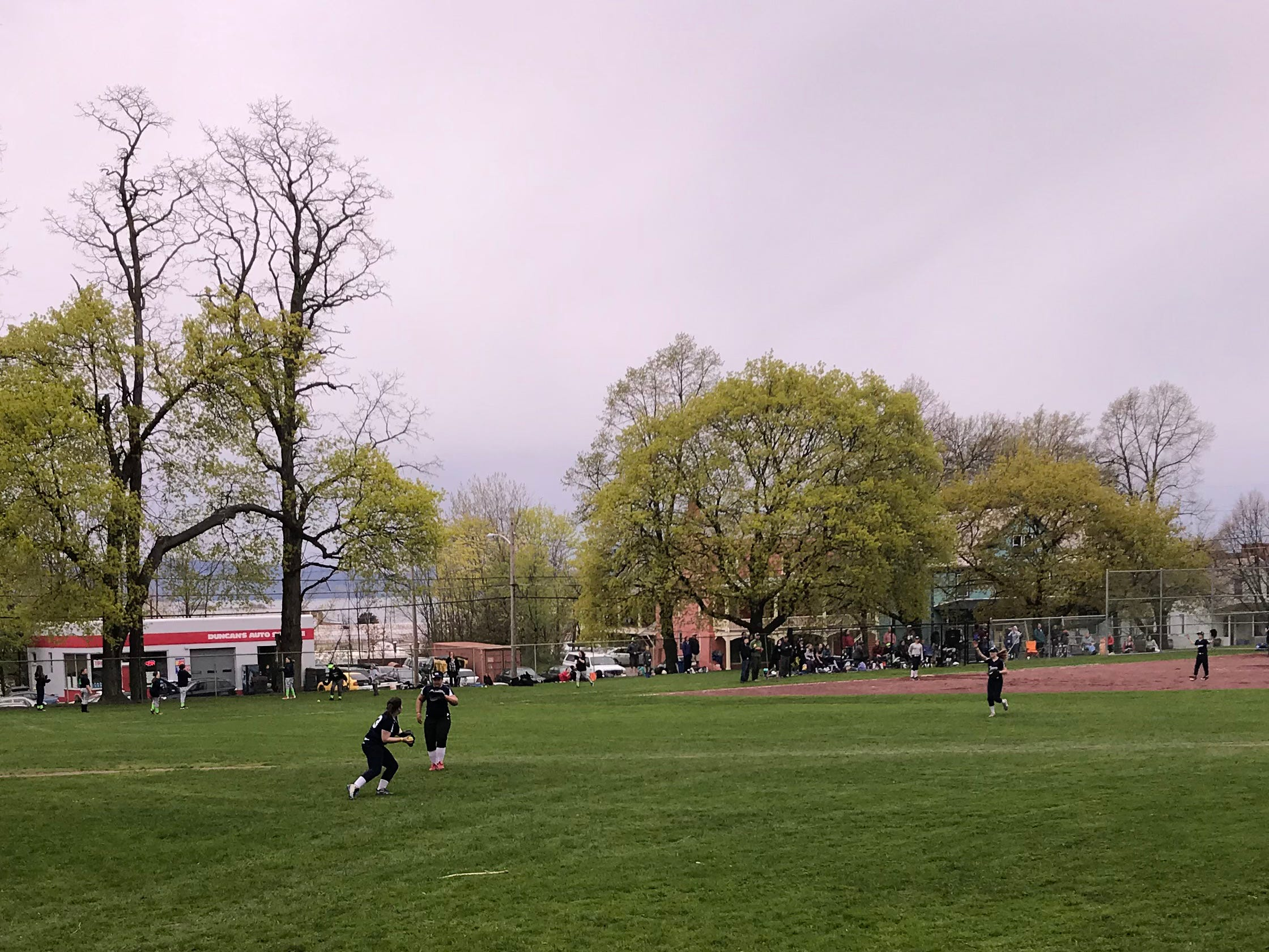 A girls softball game is in full swing in Burlington's Smalley Park on Monday, May 13, 2019.