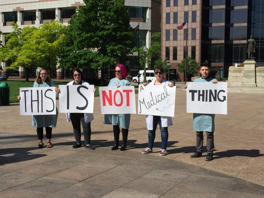 "Protesters oppose a bill to require women seeking abortions be informed of a ""reversal"" method."