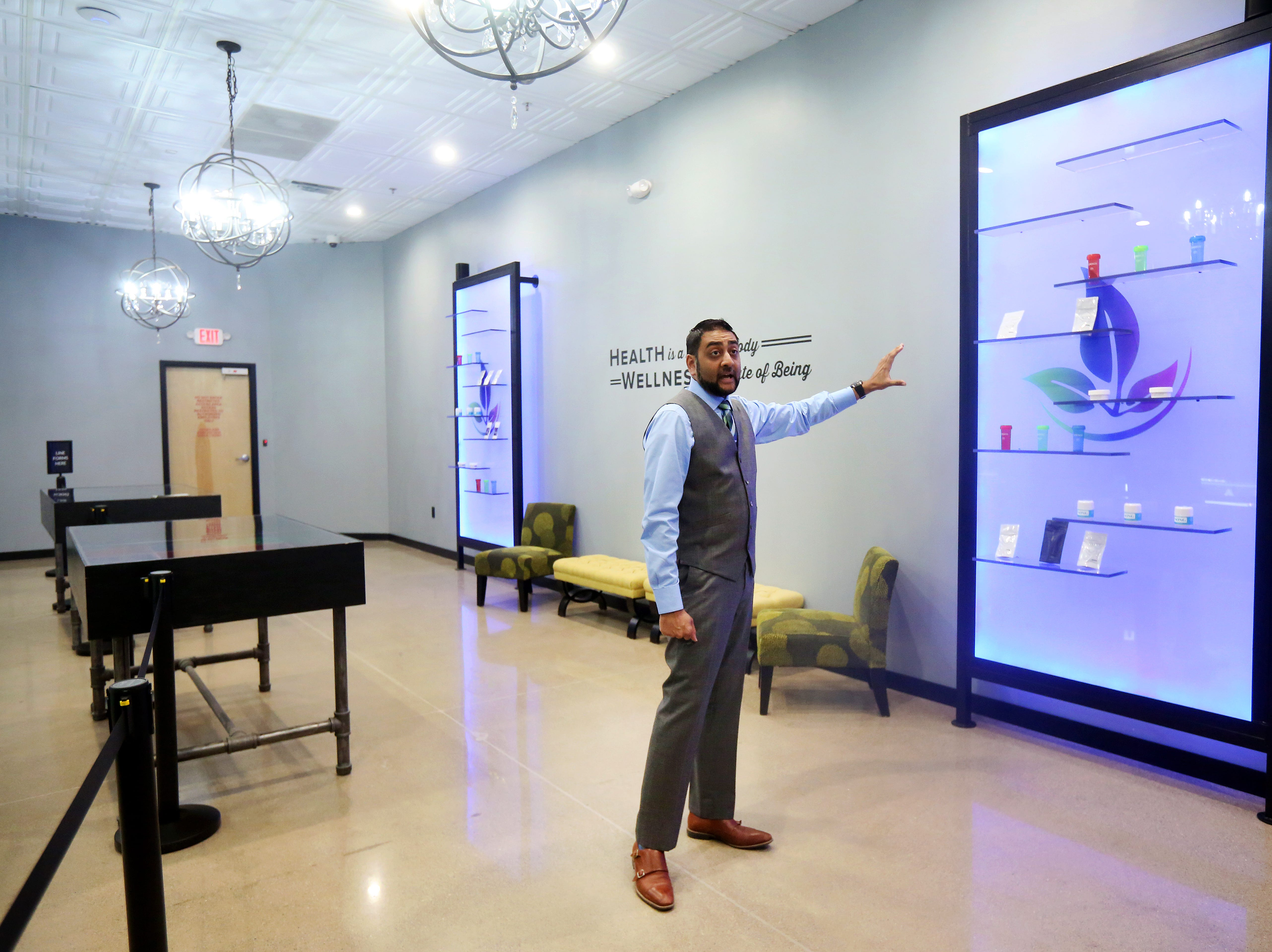 Mac Amin, dispensary manager at About Wellness Ohio, stands inside of the showroom area of the Lebanon facility. Ohio law limits patients to a 90-day supply of medical marijuana.