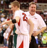 Dan Fleming, right, La Salle's all-time wins leader as a coach, celebrates with his son Ryan Fleming (25) in the fourth period of the Division I state championship March 26. La Salle won 59 to 40 over Northland.