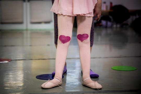 Ella Williams wears tights with hearts on the knees for her first Ballet Moves class at the Cincinnati Ballet Saturday, January 26, 2019.