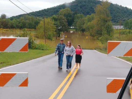 David Carter and daughters Morgan, 15, and Alyssa, 10, survey flooding from a recent rain in the Piketon area. The family lives near an area of Pike County, Ohio, recently identified as being contaminated with enriched uranium and neptunium.