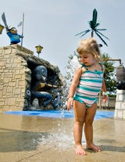 Karma Fecher, 2 of Westwood, stands in the spray at Parky's Pirate Cove at Miami Whitewater Forest in 2008.