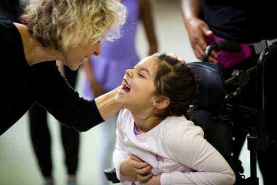 Evelyn Ortiz thanks Donna Grisez at the end of her Ballet Moves class at the Cincinnati Ballet Saturday, February 2, 2019. Every class ends with the dancers taking a bow and thanking the volunteers and themselves.