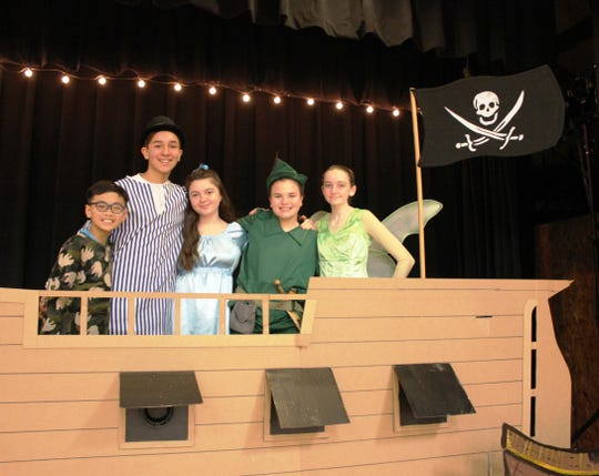 St. Francis  Cathedral School students performed Peter Pan, Jr. Pictured from left to right is:  Justin Bautista, Alejandro Ruiz, Sophia Sorge, Abby Castano, and Jessica Markert.