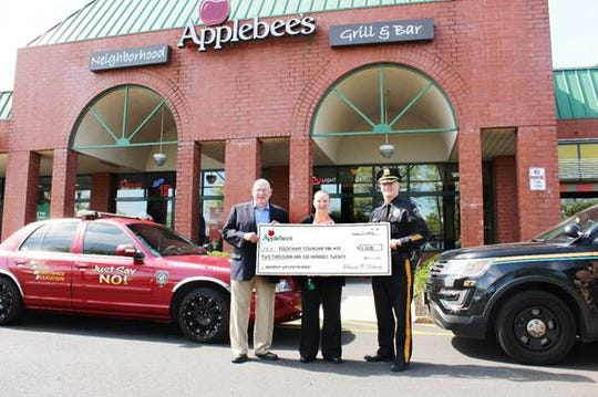 (Left to right) Bob Smith, State Senator, 17th district of New Jersey; Darsey Klein, general manager, Applebee's of Piscataway; and Michael McLaughlin, chief of Police, Piscataway Township Police Department.