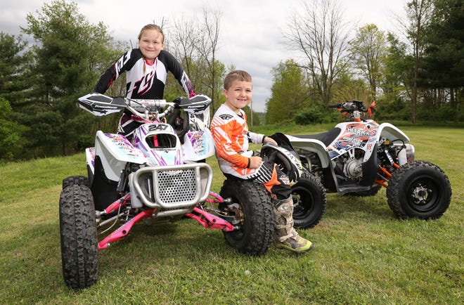Raelynn, 7, and Bryson, 6, Dickerson of Warsaw compete in the Grand National Cross Country ATV racing series.