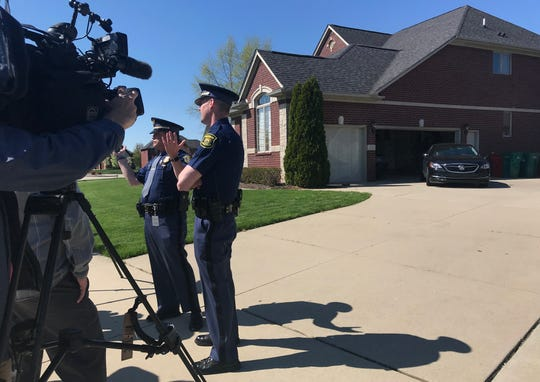 Michigan State Police speak to the media outside of Macomb County Prosecutor Eric Smith's house on Tuesday, May 14, 2019.