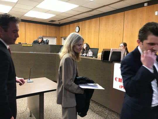 Ousted Macomb County clerk Karen Spranger walks out of a Warren district courtroom with her attorneys May 14, 2019 after a hearing on a felony larceny charge.
