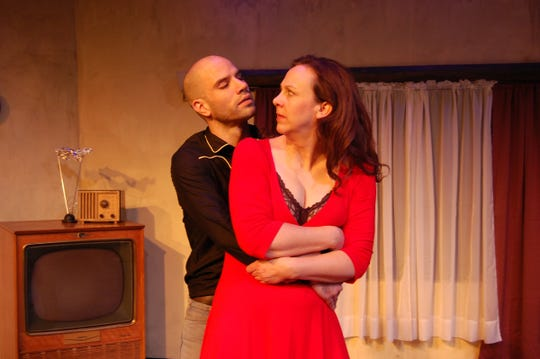 "Jonathan Davidson as Eddie and Krista Schafer Ewbank as May in Open Book Theatre's staging of ""Fool for Love."""