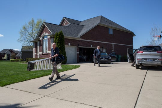 Michigan State Police raid the home of Macomb County Prosecutor Eric Smith in Macomb Twp., Mich., Monday, May 13, 2019.