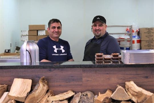 Abe Jebahi, left, and chef Ali Bazzy, co-owners of A.B.'s Amazing Ribs, a halal Texas-style barbecue joint in Dearborn Heights.