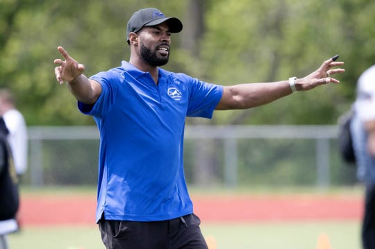 Former Detroit Lions receiver Calvin Johnson works with young players during the Calvin Johnson Jr. Foundation Catch a Dream football camp held at Southfield high school Saturday, May 20, 2017 in Southfield.
