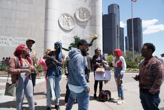 Director Lawrence Lamont talks with extras before filming a scene for an upcoming Big Sean video being filmed outside of the Coleman A. Young Municipal Center in downtown Detroit on Tuesday, May 14, 2019.