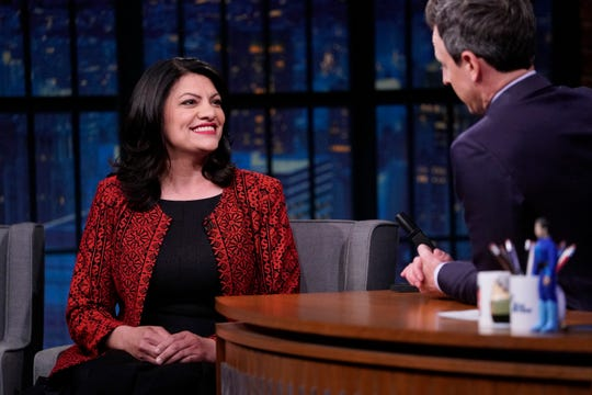 "Rep. Rashida Tlaib,left,  during an interview with host Seth Meyers for ""Late Night with Seth Meyers"" on May 13, 2019."