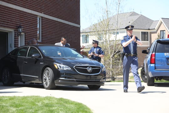 Michigan State Police raid the home of Macomb County Prosecutor Eric Smith in Macomb Twp., Mich., Tuesday, May 14, 2019.