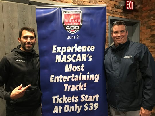 NASCAR driver Aric Almirola, left, with Michigan International Speedway president Rick Brenner at Ford's Garage in Dearborn on Monday.