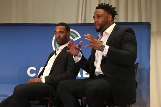 Former Detroit Lions' football players Calvin Johnson and Robert Sims talking to a crowd at the Cannabis Capital Conference in Toronto. The two gridiron stars are planning on opening medical marijuana grow operations, processing facilities and dispensaries. The conference was sponsored by Benzinga, a Detroit-based financial news company.