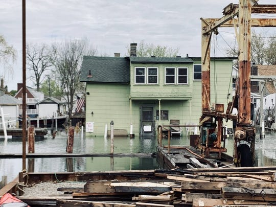 Nearly two weeks after heavy rains flooded homes, property in the Jefferson Chalmers neighborhood of Detroit was still underwater. Photo taken on Saturday, May 11, 2019.