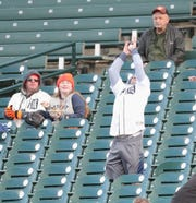 A fan catches a home run hit by a Houston Astros player vs. the Tigers, May 13, 2019 at Comerica Park.