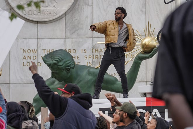 Big Sean is filmed for a new song on top of a Channel 4 news truck during a shoot for an upcoming video outside of the Coleman A. Young Municipal Center in downtown Detroit on Tuesday, May 14, 2019.