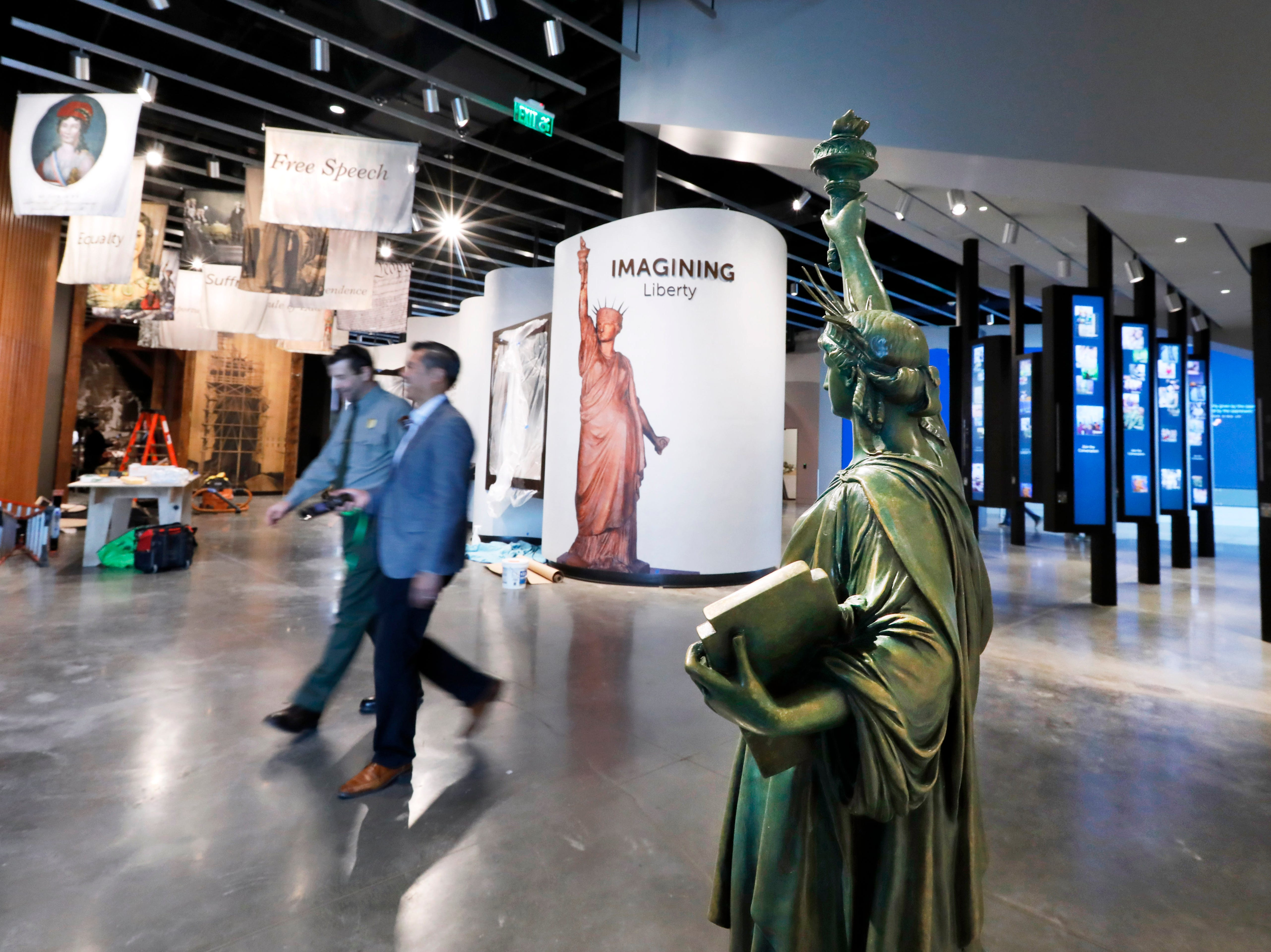 A miniature Statue of Liberty is among the artifacts displayed in the new museum on Liberty Island.