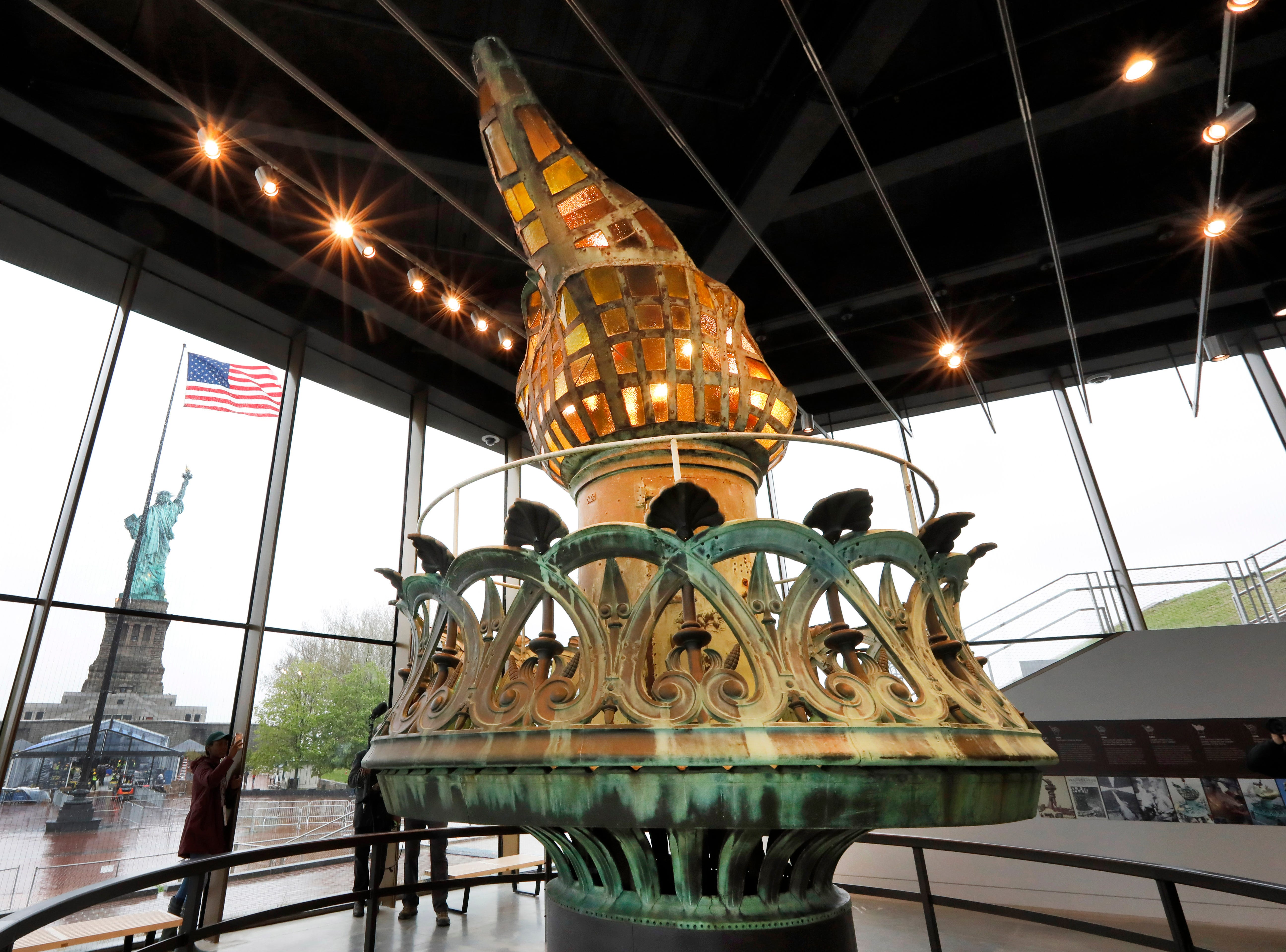 The original torch and flame are displayed in the new  museum. Other features include a look at the city skyline through the decades from the Statue of Liberty's eyes, as well as how the statue itself looked before its copper exterior turned green.