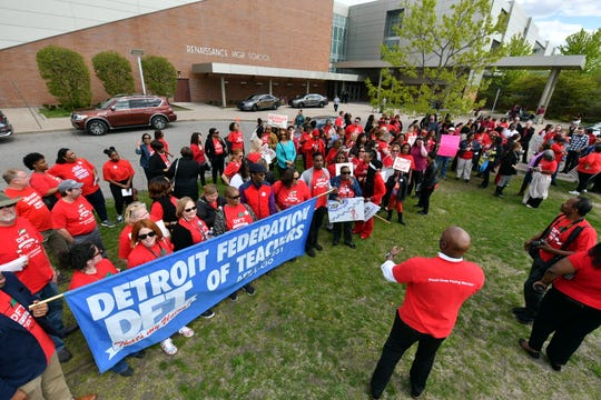 Detroit teachers gather after school Tuesday at Renaissance High to protest at a school board meeting over teacher pay, building conditions and class sizes.
