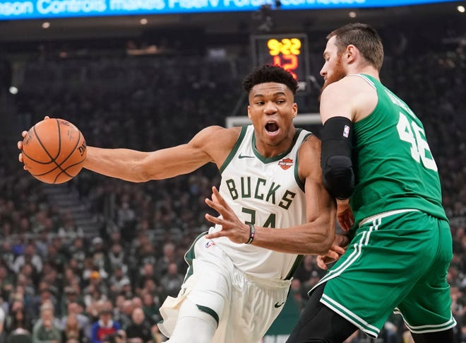 NBA Most Valuable Player Giannis Antetokounmpo averaged 27.7 points and 12.5 rebounds in his sixth season with the Bucks.