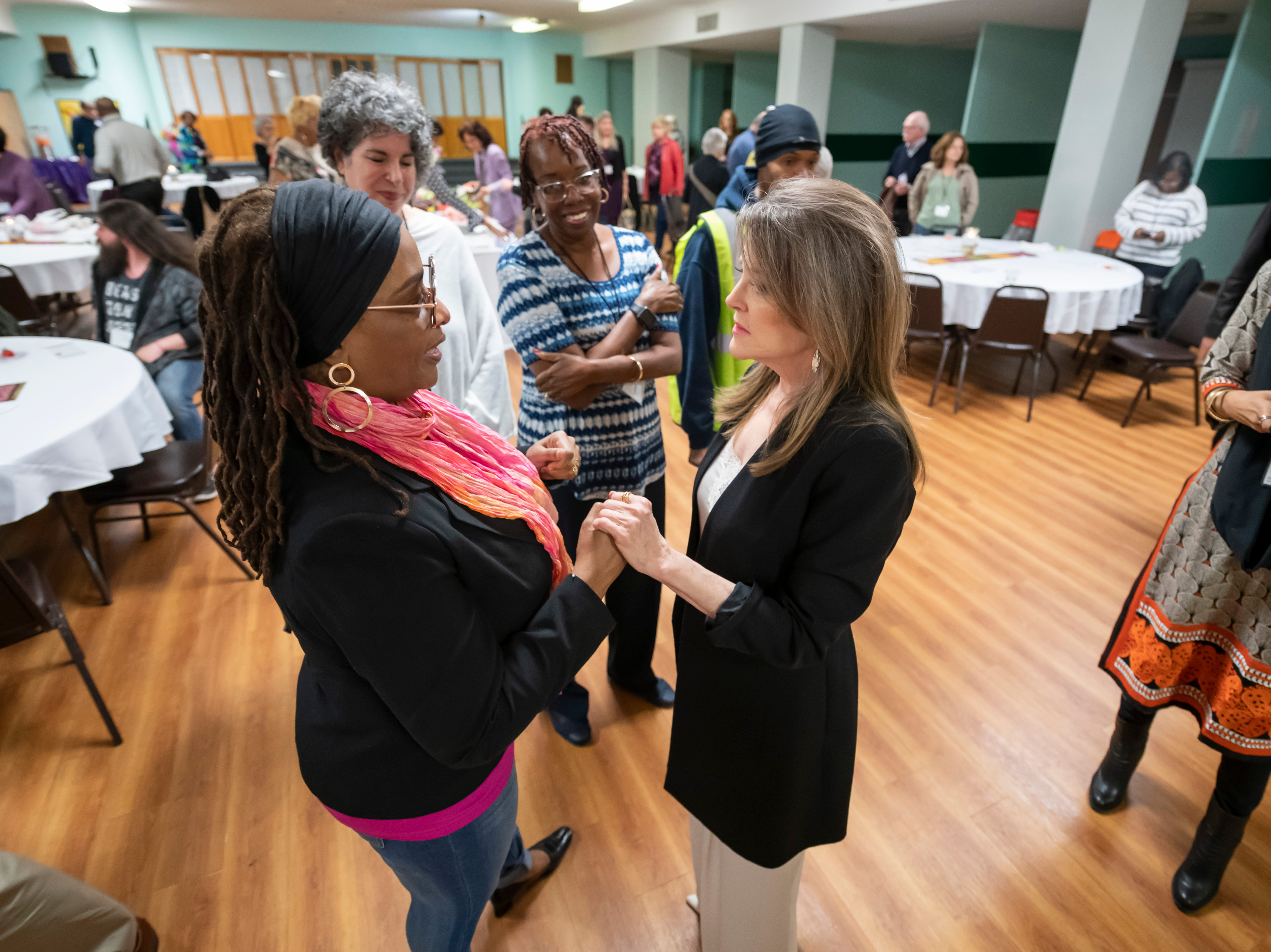 Author and Presidential candidate Marianne Williamson chats with Adelina Israel, of Detroit, before a town hall at the Detroit Unity Temple, in Detroit, May 13, 2019.