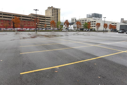 When the Ilitch group took control of the parking lot at Cass and Temple, it wiped out parking for a nearby apartment building.