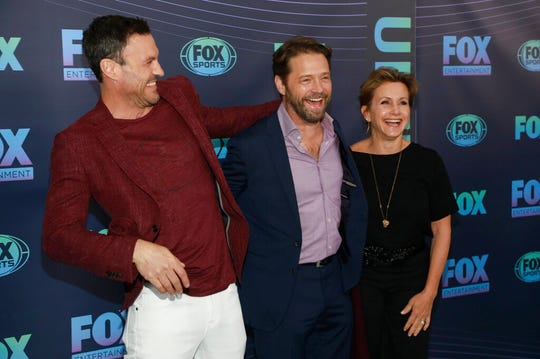 "Brian Austin Green, from left, Jason Priestley and Gabrielle Carteris, from the cast of ""BH90210,"" attend the FOX 2019 Upfront party on Monday, May 13, 2019, in New York."