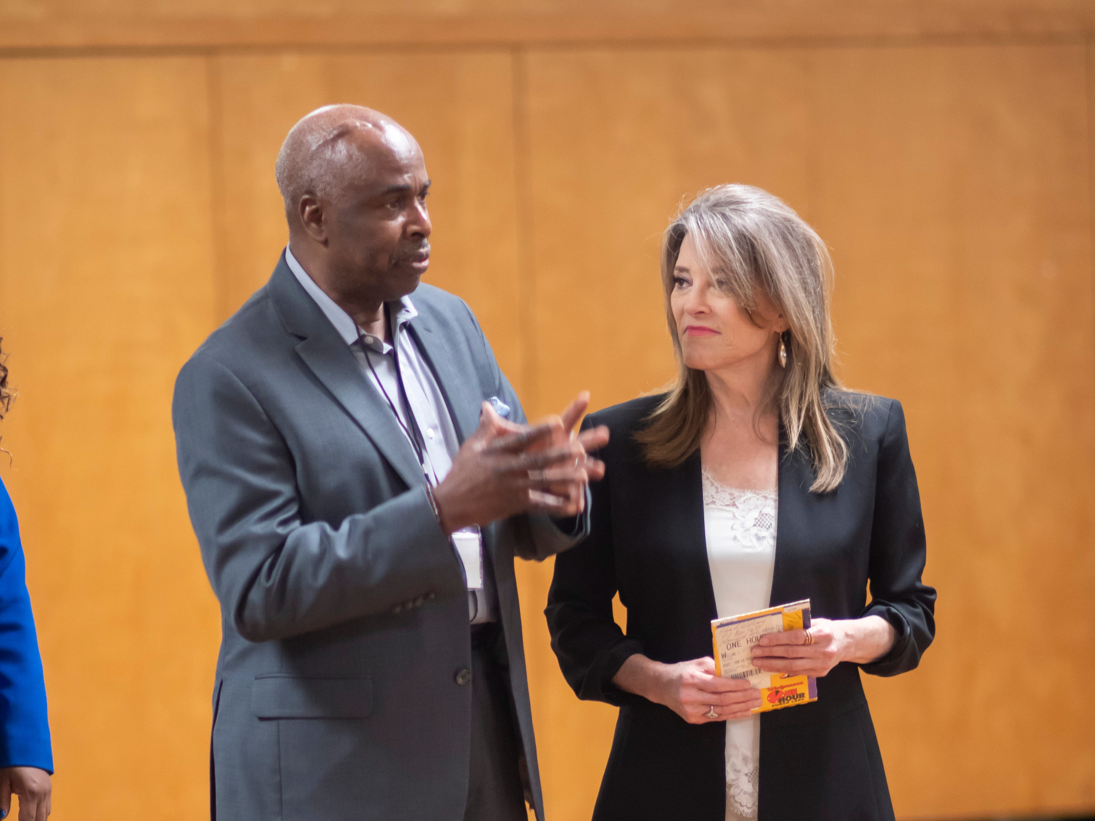 Pastor Gregory Guice, left, speaks about author and Presidential candidate Marianne Williamson during a VIP reception before a town hall at the Detroit Unity Temple.