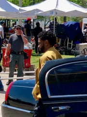 Big Sean exits a limo in Detroit's Spirit Plaza.