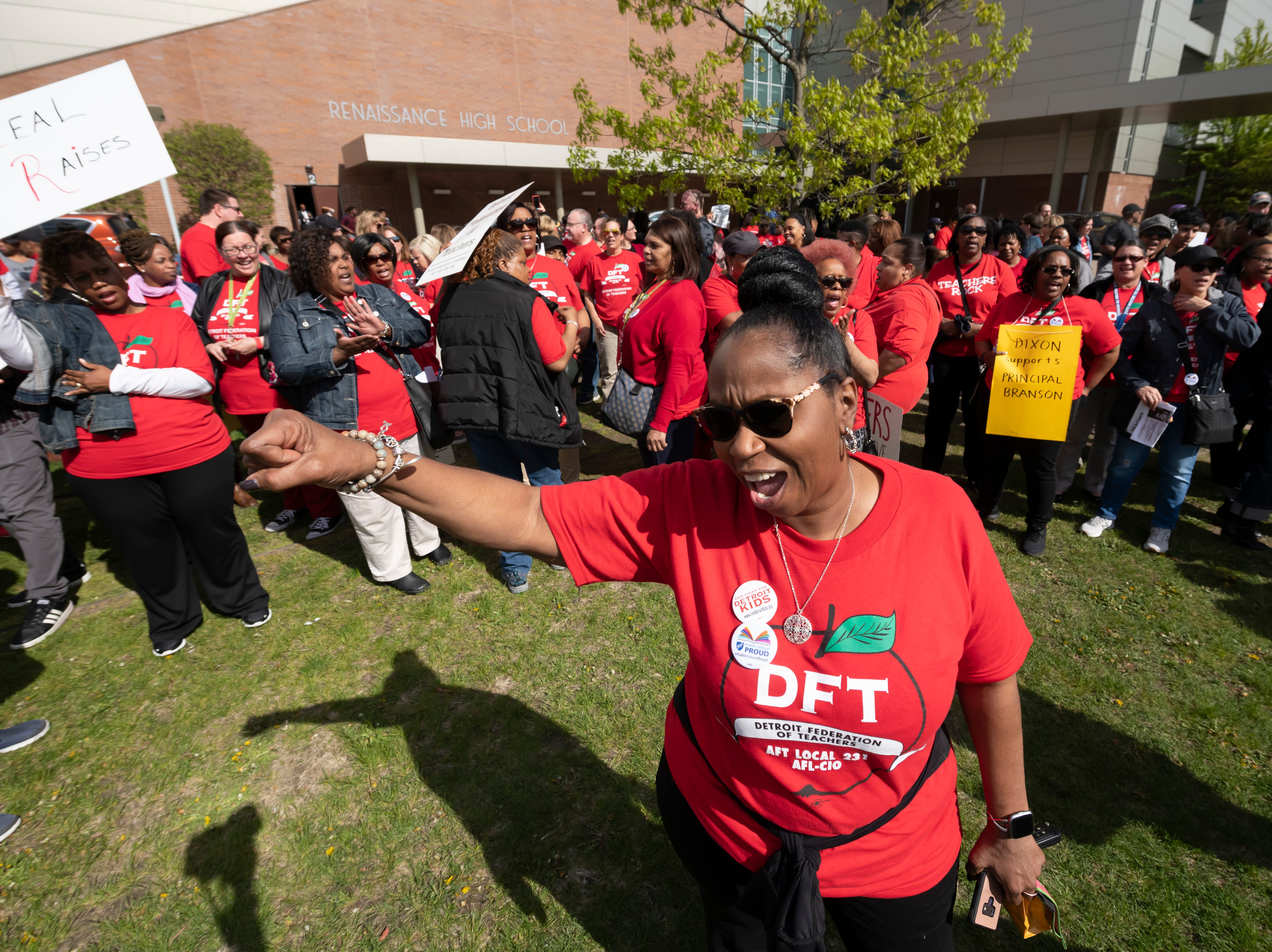 Welia Dawson, a teacher at Paul Robeson Malcolm X Academy, joins with hundreds of Detroit teachers protesting before a school board meeting at Renaissance High school, in Detroit, May 14, 2019. The teachers are upset over a new calendar, teacher pay, building conditions and class sizes.   (David Guralnick / The Detroit News)