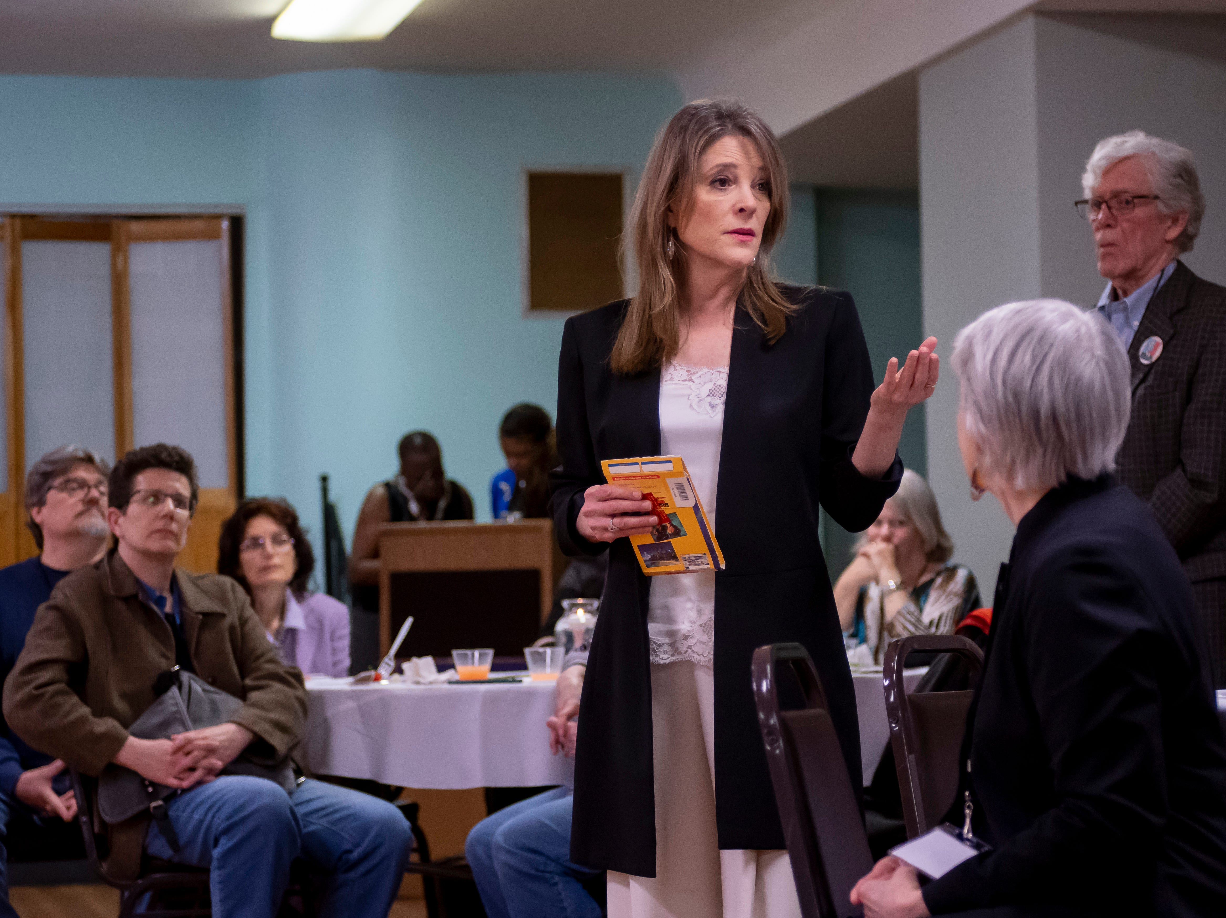 Author and Presidential candidate Marianne Williamson, chats during a VIP reception before a town hall at the Detroit Unity Temple.