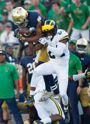 """Michigan athletic director Warde Manuel says there's """"interest"""" in maintaining the series with Notre Dame."""