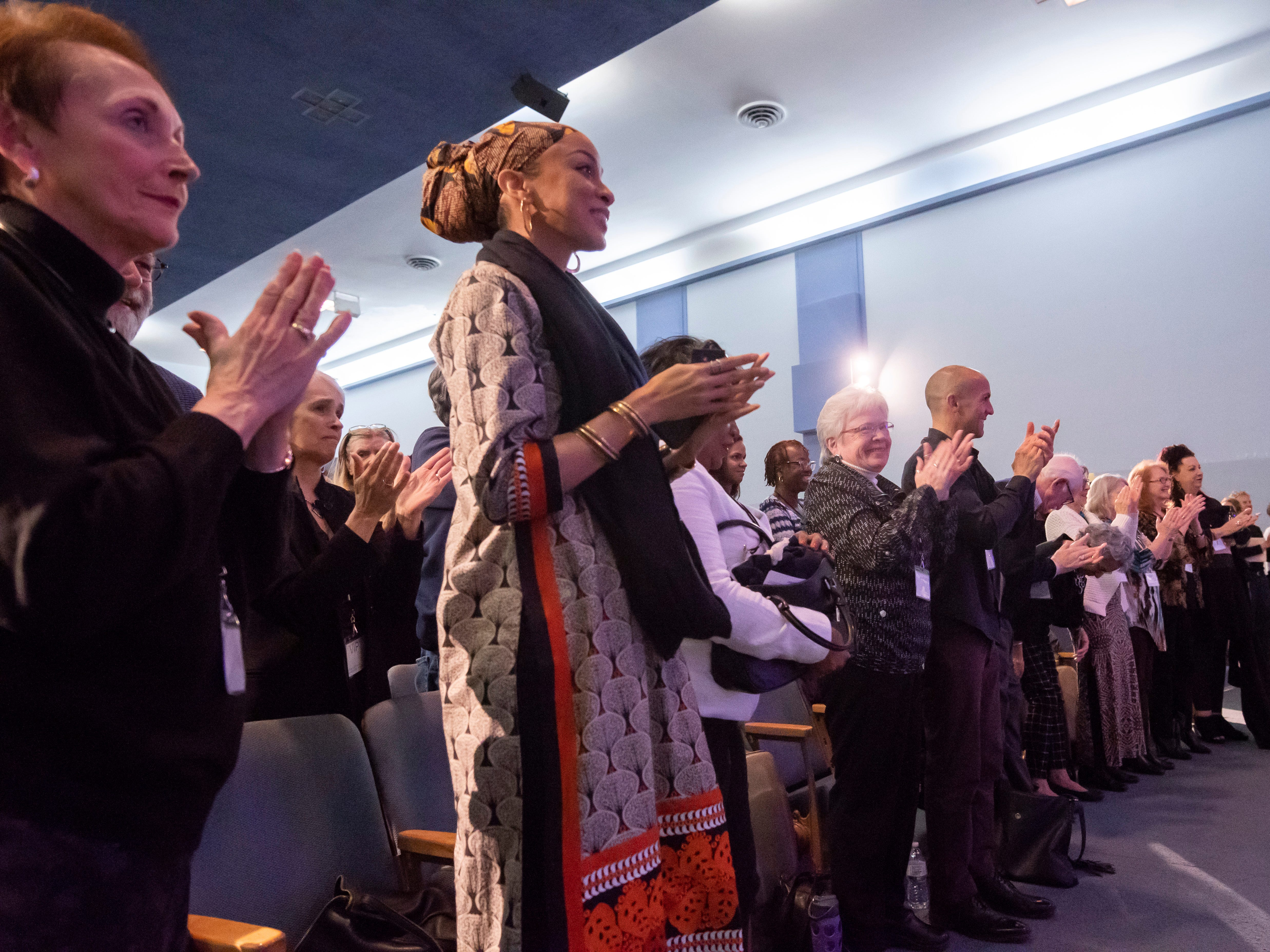 The audience gives a standing ovation for author and Presidential candidate Marianne Williamson, during atown hall at the Detroit Unity Temple.