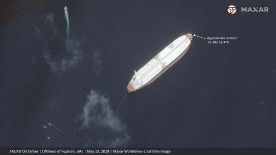 This satellite image provided by Maxar Technologies shows the Saudi-flagged oil tanker Amjad off the coast of Fujairah, United Arab Emirates, Monday, May 13, 2019.