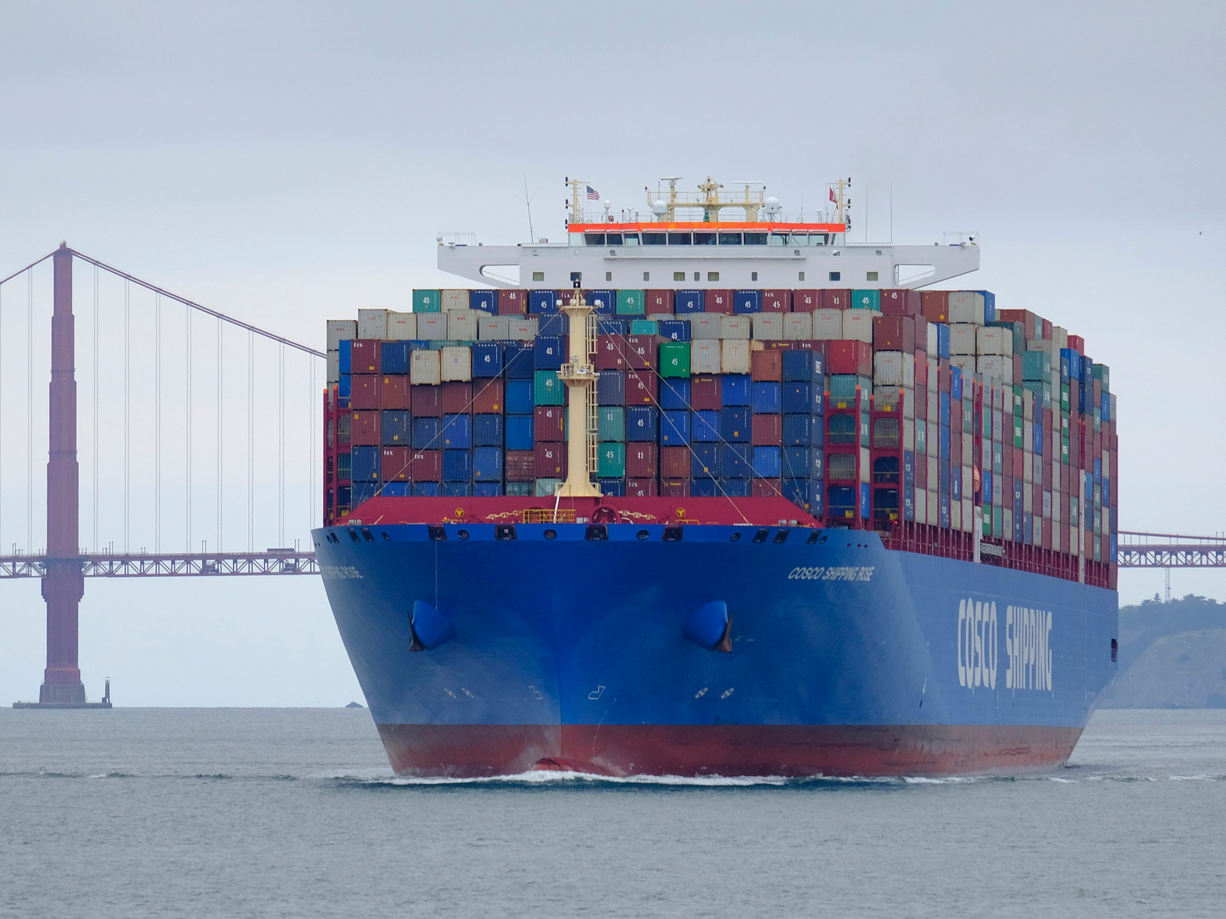 A Cosco Shipping container ship passes the Golden Gate Bridge Tuesday, May 14, 2019, in San Francisco bound for the Port of Oakland. The United States and China are raising tariffs on tens of billions of dollars' worth of each other's imports, escalating a trade war, spooking financial markets and casting gloom over the prospects for the world economy.